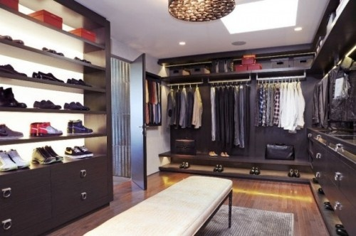 Modern boutique vibe. Love the rich wood and fixtures. Could easily work for a woman, as well.