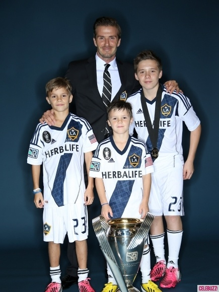 David Beckham celebrates his final game and win with the L.A. Galaxy with sons Romeo, Cruz and Brooklyn. The Galaxy beat the Houston Dynamo 3-1 and took home the 2012 MLS Cup Dec. 1, 2012.