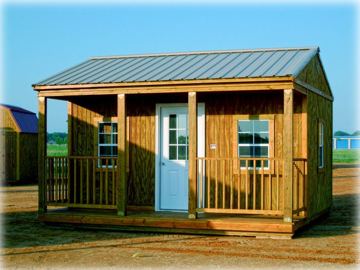 Storage building with covered porch for a craft woman for Shed with porch