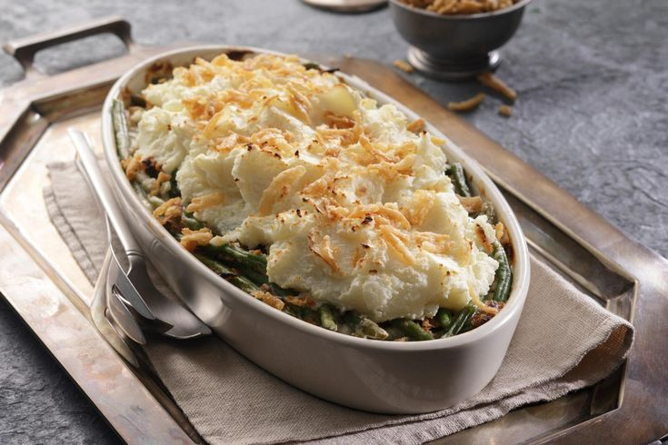 Idahoan Mashed Potato Topped Green Bean Casserole combines two favorites – green bean casserole and mashed potatoes – into one! Not just for holidays anymore!