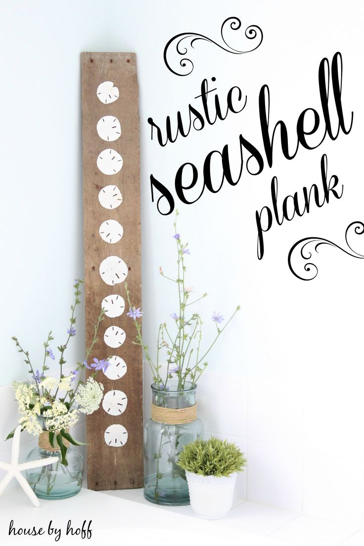 What a cute way to display the sand dollars found on the beach - just hot glue them onto a rustic board of wood