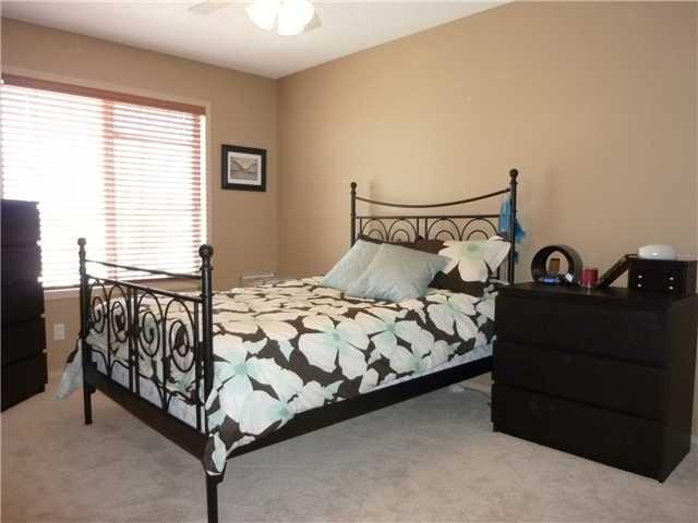 spare bedroom with a walk-in closet  www.heatherdavis.ca