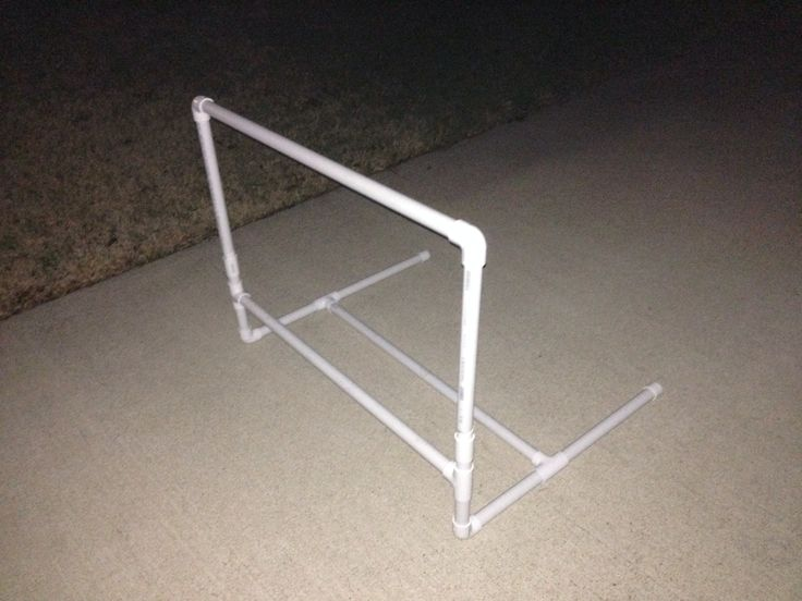 """Track hurdle I made out of PVC pipe for my daughter. It adjusts from 30"""" to 33""""."""
