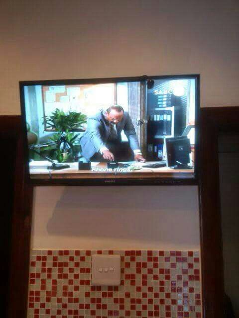 TV wall mounted in kitchen with tv link eye.