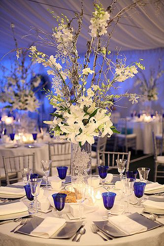 Blue and Silver; like the height of the arrangement; more blue & no lillies, please