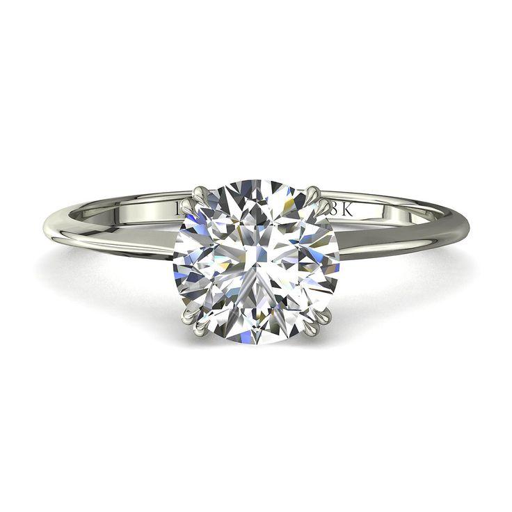 Solitaire bague de fiançailles diamant 1 carat or blanc -1954  Diamants et Carats vous propose la 1954, une bague solitaire diamant à la ligne très épurée du 21ème siècle et haute joaillerie. Sertie de 4 doubles griffes, la pierre centrale, un diamant rond de la forme du brillant est de 1 carat.  Fabriquée dans nos ateliers,cette bague de fiançailles se décline en or jaune,blanc,ou rose de 18 carats.  - Couleur : I-H-G-F-E-D - Pureté : SI-VS-VVS - Poids diamant central : 1 carat - Diamètre…
