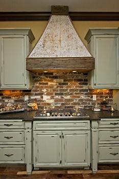 distressed cabinets with brick backsplash. LOVE
