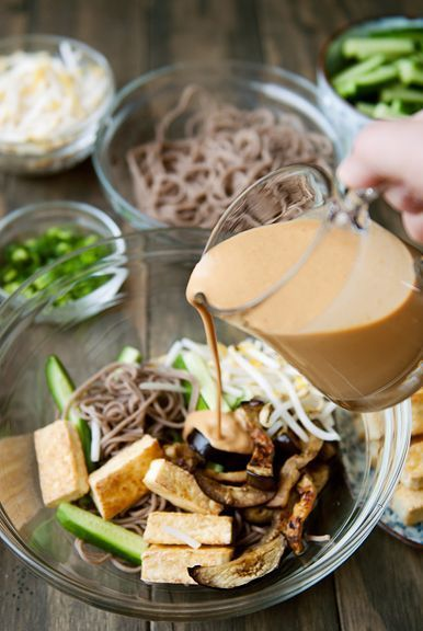 japanese soba noodles salad with creamy sesame sauce, grilled eggplant and tofu