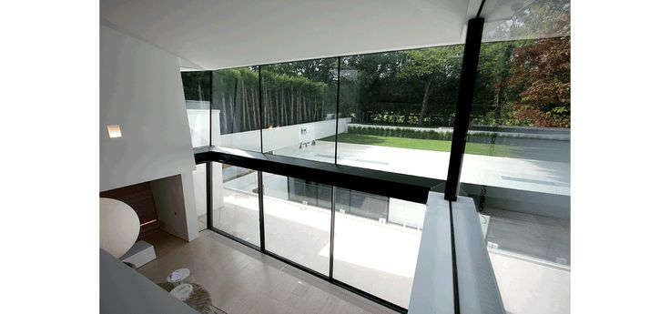 Double height rear glass box with sliding glass doors to for Sliding glass back door