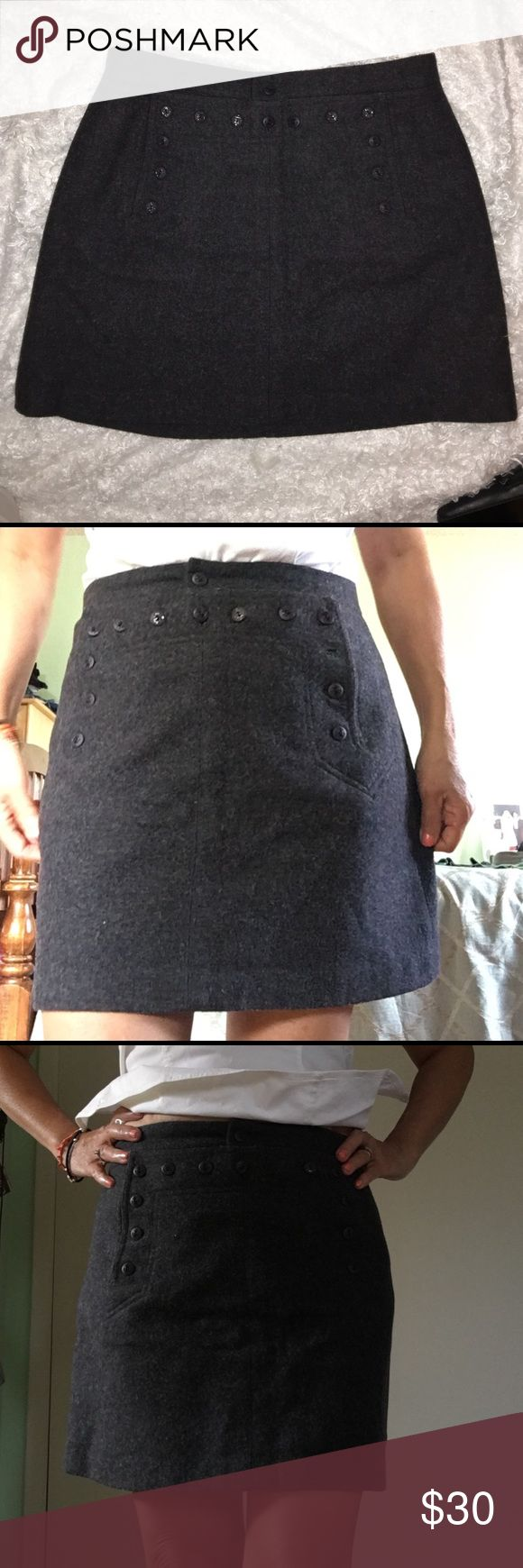 Mini gray wool skirts So cute and comfyyy size 4 , 80% wool 20% nylon. a lot of buttons in the front for styles , has two packet in the back also the front Aeropostale Skirts Midi