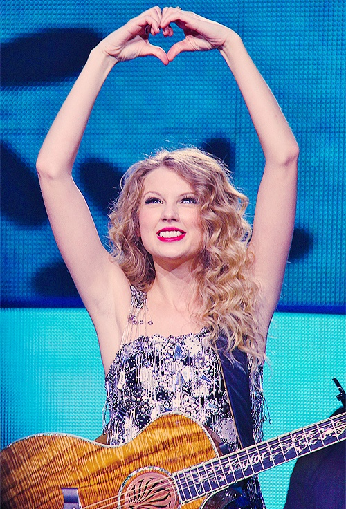 when I frist found out about Taylor Swift I couldn't help but fall in love with her and her music I loved her that first moment of I knew that Tay existed