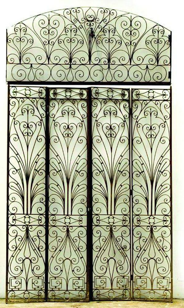 Two pairs of cast iron gates with foliate and scroll