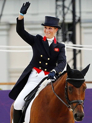 Zara Phillips jumped into the history books on Tuesdays Day Four of the London 2012 Summer Olympic Games when she became the first British royal to win a silver Olympics medal  as part of the five-member Team GB equestrians dramatic morning.