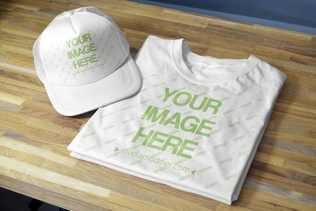 Download A Double Mockup For Showcasing Your Shirt And Cap Hat Designs A Folded T Shirt And A Blank Snapback Hat Lying On A Woode Caps Hats Clothing Mockup Hat Designs