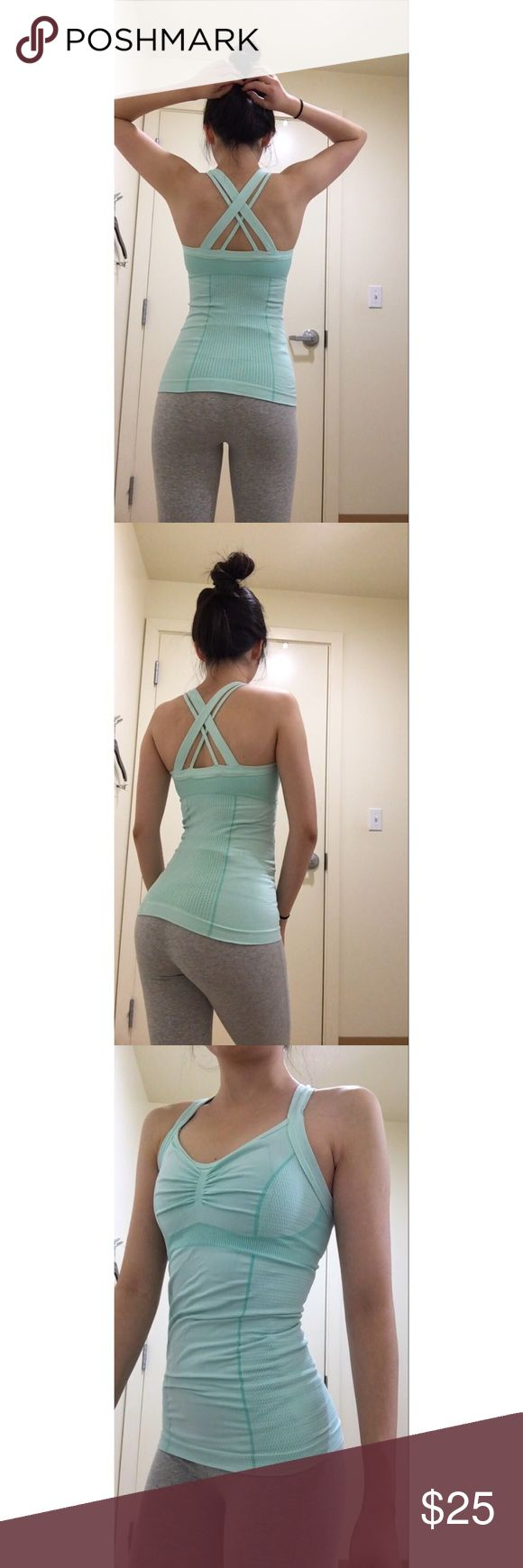Zella tank NEW Zella mint tank. Size XS. The color is gorgeous! I love the crisscrossing on the back. The quality is awesome. The fit is pretty tight so it keeps everything in place. The design is super flattering.#zella #workouttanks #gym #workout #workoutgear #comfy #workoutcloth #fitness Zella Tops Tank Tops