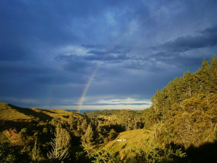 Dramatic evening light coupled with a rainbow