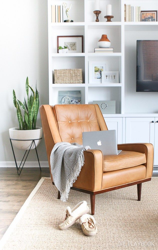 Loving our new cognac leather chair. It's the perfect addition to this family room. So comfortable and adds some extra seating to the space.