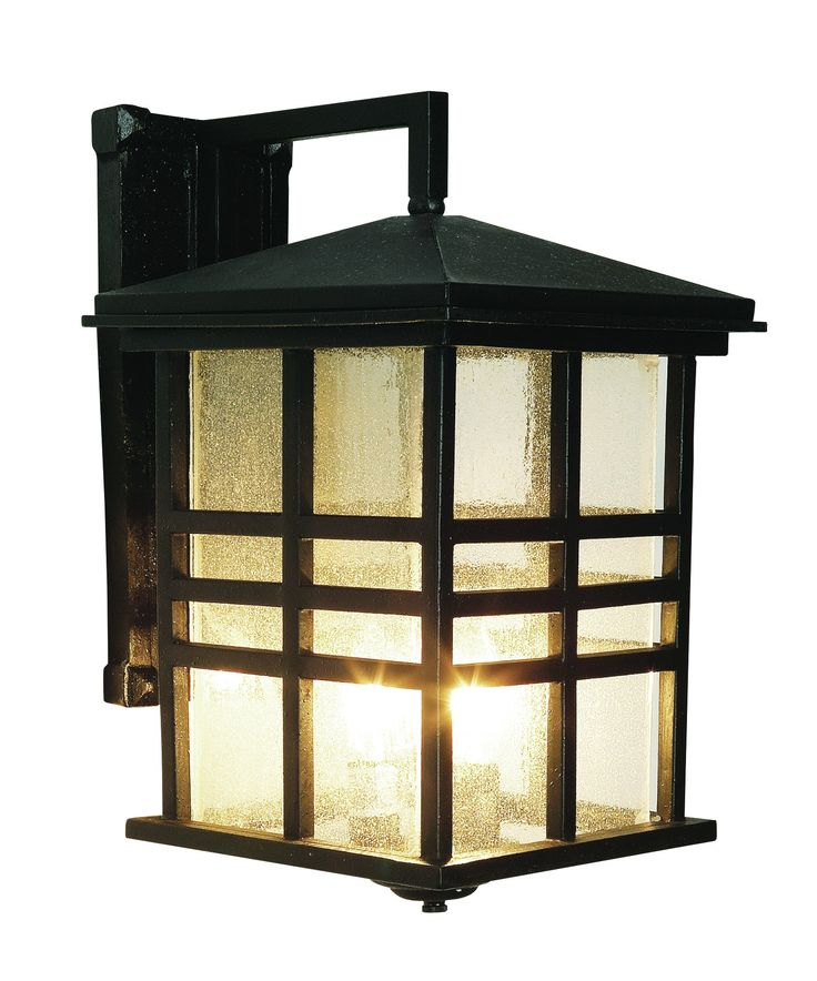 Rustic mission style outdoor coach light perfect for rustic cabin décor. Clear seeded glass in three bar frame. Finish: Black Height: 16'' Width: 10'' Depth: 13'' Bulb: 3-Candelabra - E12 Wattage: 60