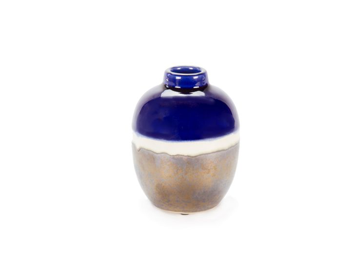 Orbit Indigo Gold Vase from www.designarthouse.com.au.  Contemporary navy, cream and gold metallic glazed ceramic luxe vase with a turned lip. Great for small spaces, side tables or shelves. Alternatively group together to create a collected look.   Dimensions: 12cm H x 8cm W