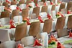To have low Budget Wedding, instead of using designer table cloths, you can use white linen as this is cheap & easily available. Chair covers can be avoided & simple chairs can be used.