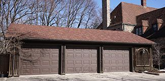 Residential three car garage doors are serviced, installed, repaired, and maintained by Action Garage Doors highly qualified technicians of Crowley Texas a suburb of the Dallas and Fort Worth Area