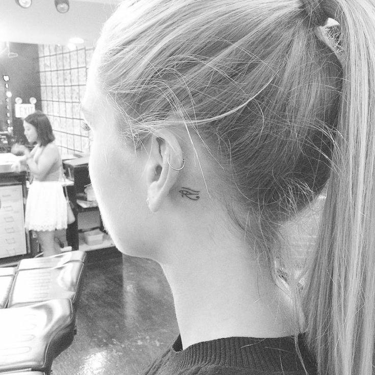 Tiny eye of Horus tattoo behind the left ear. Tattoo artist: Jon Boy · Jonathan…