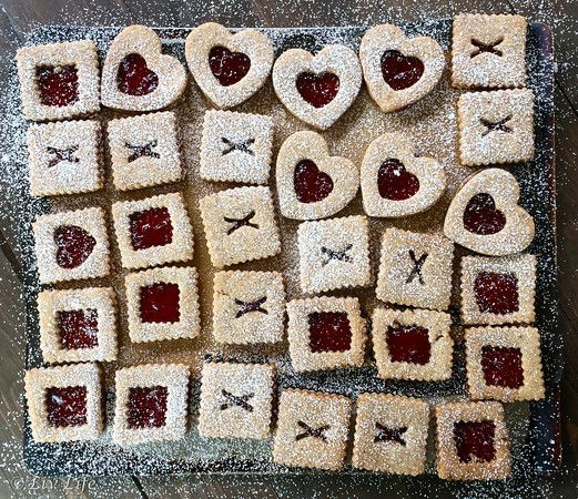 Fine Cooking's Linzer Cookies.... these are with Strawberry Jam! #cookies #baking @livlifetoo