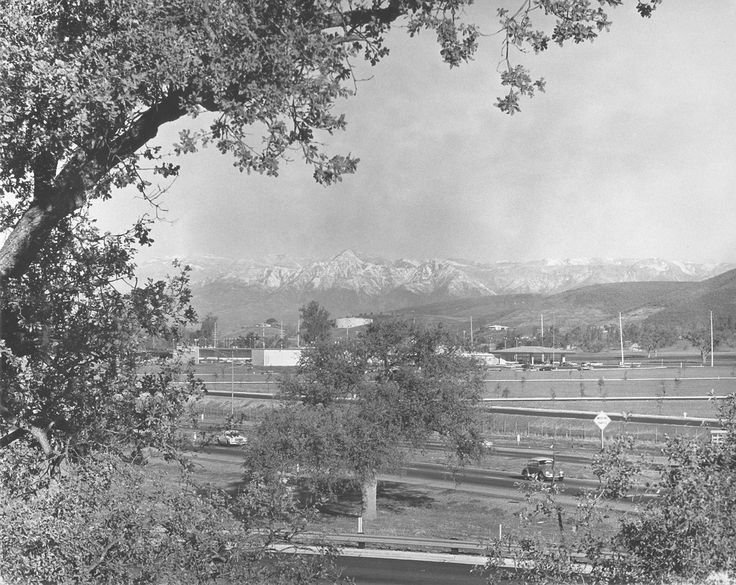 """Snow on the Topa Topa Mountains. Looking Northwest, over the 101 freeway, with the first car dealership, Courtesy Chevrolet, in center. Circa 1968.  Photo donated by photographer Herb Noseworthy.  Conejo Through the Lens, Thousand Oaks Library Special Collections . Photo ID # CTLnos17  There are no known U.S. copyright restrictions on this image. The Thousand Oaks Library requests that, when possible, the credit statement should read: """"Image courtesy of Conejo Through the Lens, Thousand…"""
