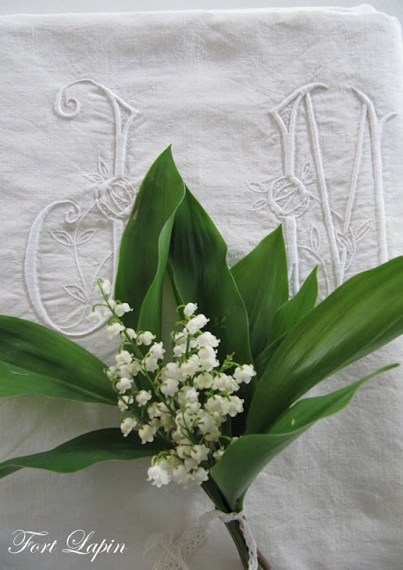 Lily of the valley and monogrammed linen