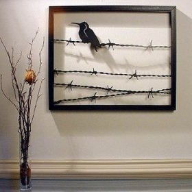 Metal sculpture.  Intriguing.  Frame from old pallets, use barbed wire.