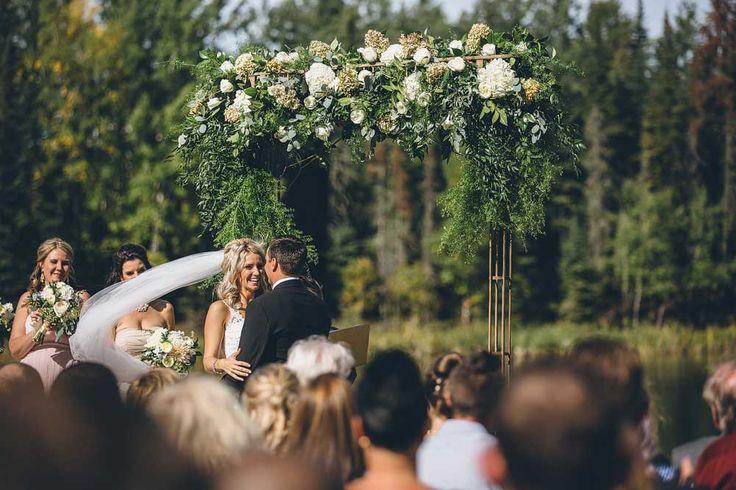 Breathtaking flower arch! Elk Ridge Resort Wedding.  https://mjand.co/elk-ridge-resort-wedding-photo/#!prettyPhoto[1]/https://mjand.co/me/uploads/2015/11/MJCO_WEDD_AndyAllison_0089.jpg