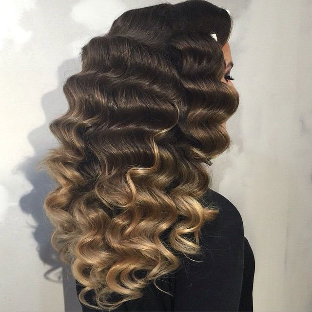 Curls: It looks like this curl was achieved using the finger wave technique, based on the length and spacing of the curls. It looks like she used either a gel or hairspray to make the curls so defining.