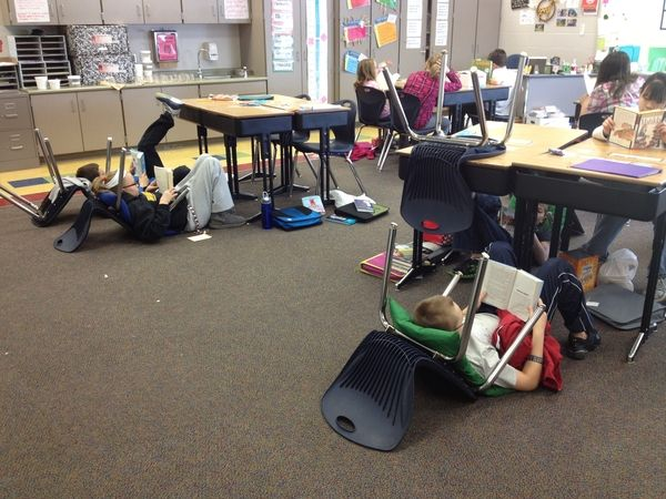 a relaxing place to read Here is a creative teaching idea: By turning their chairs over, each student gets their own, relaxing space to read! Repinned by The Sensory Spectrum.