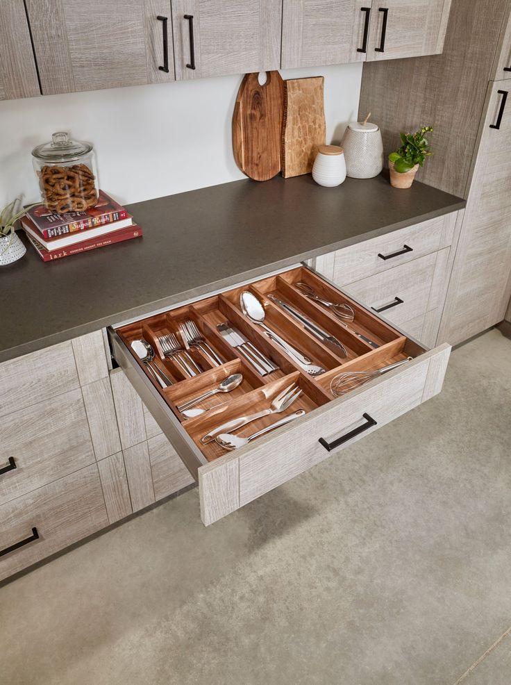 Walnut utensil organizer paired with walnut cutlery organizer by Rev-A-Shelf | https://www.rev-a-buzz.com/profile/walnut