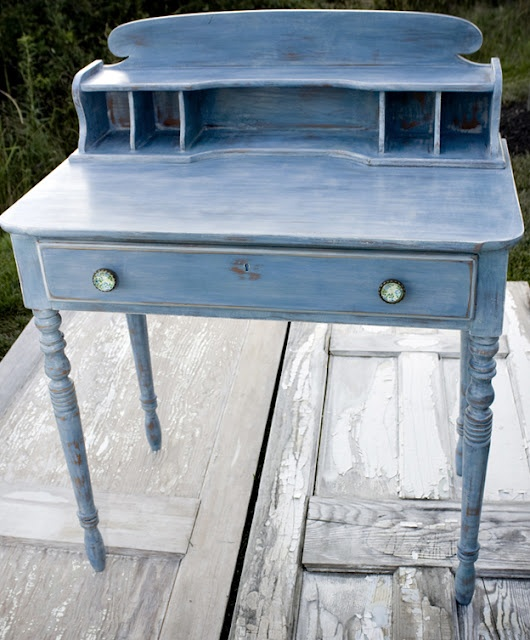 ASCP - 2 coats of Greek Blue. When dry, sand then wax with clear wax.  Mix Provence, Paris Grey and Aubusson Blue on a paper plate and dab the paint and wax and blend it into the piece.  Distress in areas to bring more of the Greek Blue out and add a touch of Old White on the edges to highlight the shape.