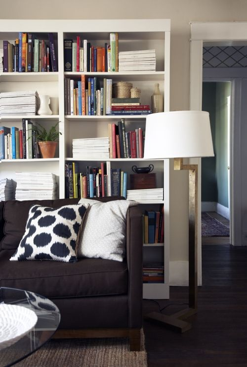 Sofa BedSleeper Sofa Bookshelves behind couch Also like the lamps on either side