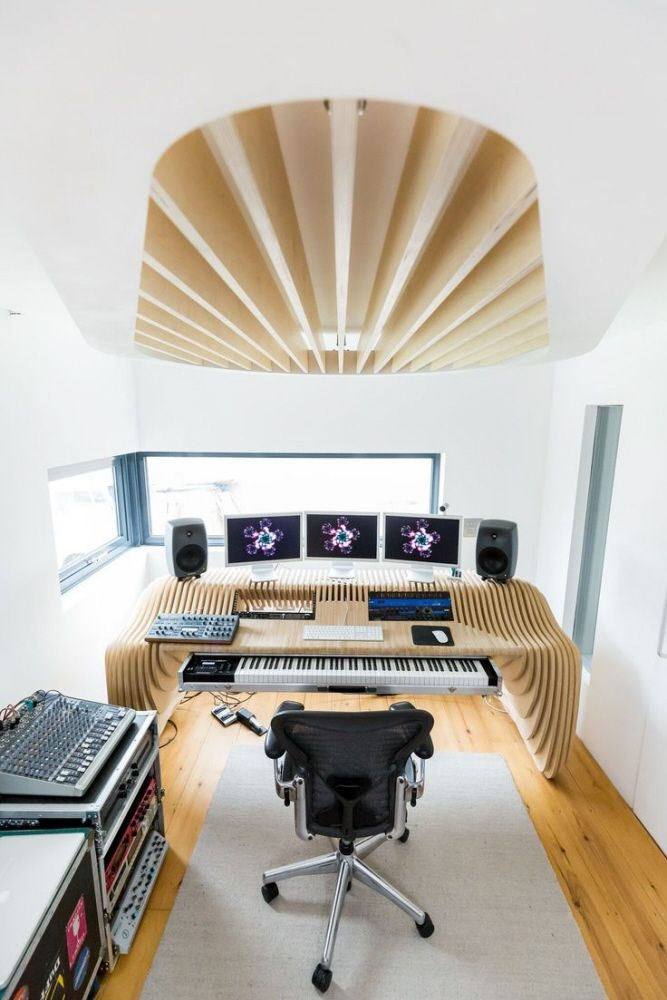 Studio desk and acoustic baffle for composer Timo Baker. Desk: 18mm birch plywood M10 studding 32mm Steel Tube Laser cut 6mm steel and polyethylene sliding mechanism Baffle: 18mm birch plywood Lamin...