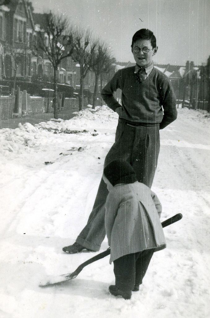 Cranbourne Road in Muswell Hill, winter 1947...That's right put your back into it kid!