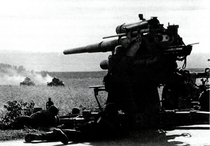 A German 88mm Flak 18 leveled two burning SOMUA S35 tanks in France, 1940.