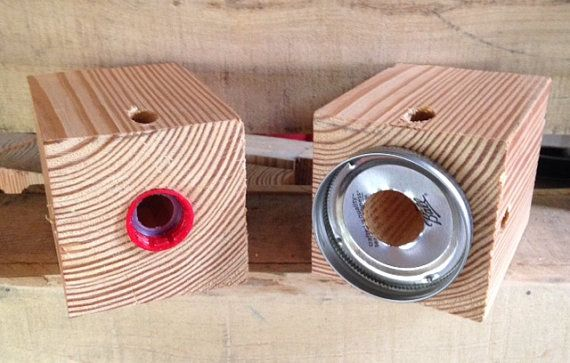 """Carpenter Bee Traps....Bottle or Mason Jar by CRWWoodworks on Etsy  Drill a 1/2"""" hole angled upward and a larger hole down the middle"""