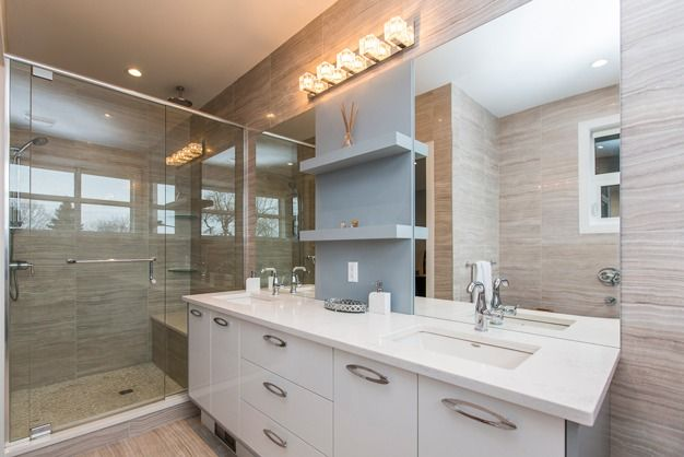 Bathroom finish, including walk-in shower and accent lighting, in our 235 Carleton Ave. property.