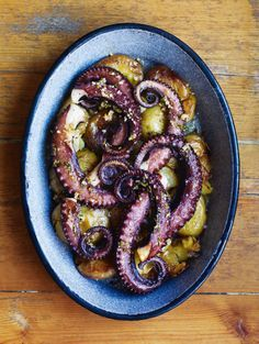 Octopus with smashed potatoes, olive oil and piso recipe from Lisboeta by Nuno Mendes | Cooked
