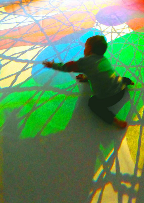 Touching light-Reflections Nursery Add cellophane across window to cast coloured reflections
