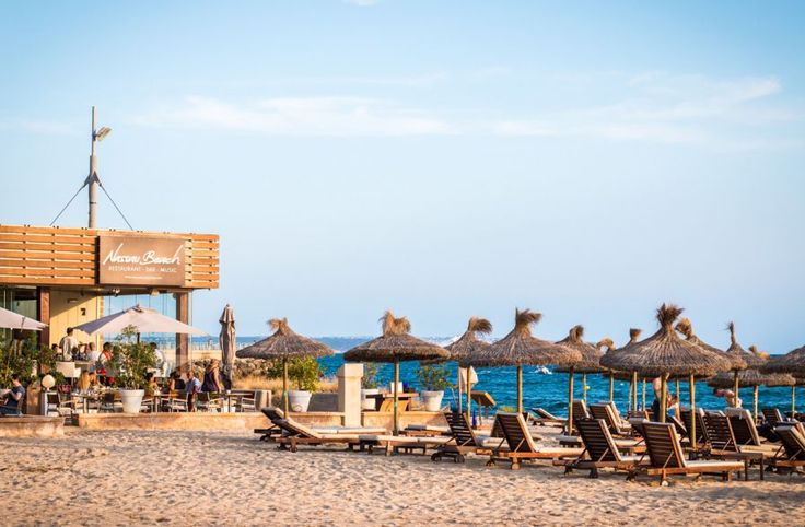 Enjoy a beach day and a lunch by the sea at Nassau in Palma de Mallorca.