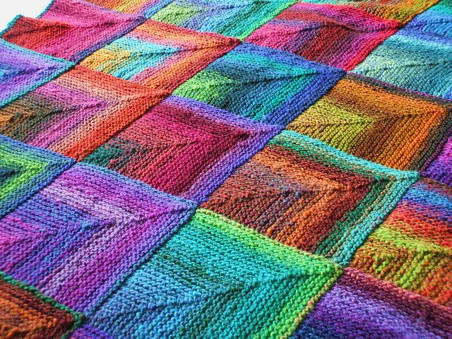 Mitered squares knitted blanket (she used noro lure yon yarn)