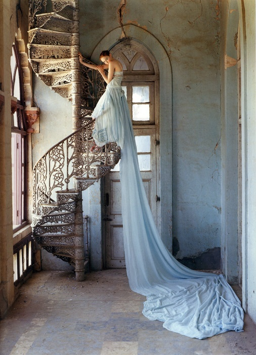 I know 99% of people will see that amazing dress first... But I see the amazing staircase.