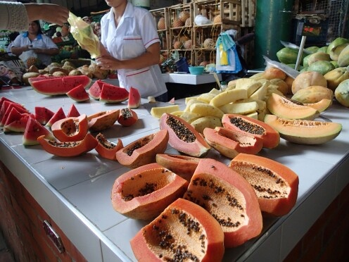 Papaya and other fruits for sale in the market of San Gil Colombia