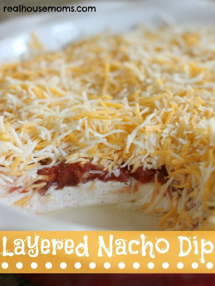 Layered Nacho Dip - I think I may stick it in the oven for a bit until the cheese on top is melted and bubbly