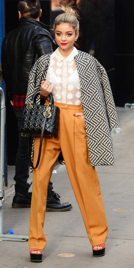 Shop our favorite cocoon coats inspired by actress Sarah Hyland.