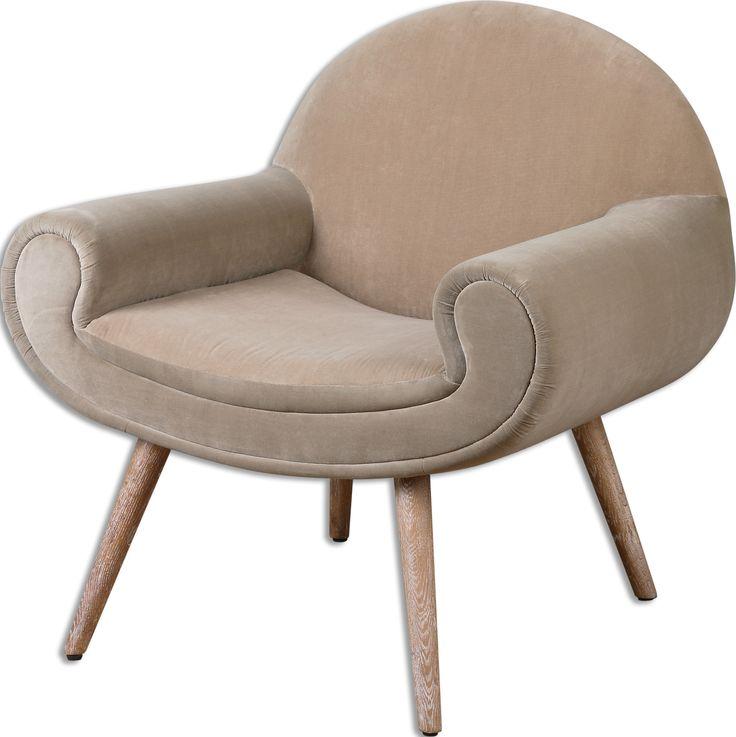 Американское кресло необычной формы приятного кремового цвета на светло-коричневых ножках. Ножки изготовлены из древесины дуба. Высота сиденья 46 см.             Метки: Кресла для дома, Кресло для отдыха.              Материал: Ткань, Дерево.              Бренд: Uttermost.              Стили: Арт-деко, Классика и неоклассика.              Цвета: Бежевый.